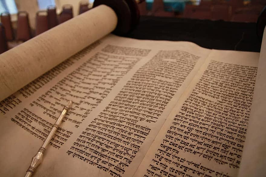 God dictated to Moses the first five books of the bible called the Torah Scrolls
